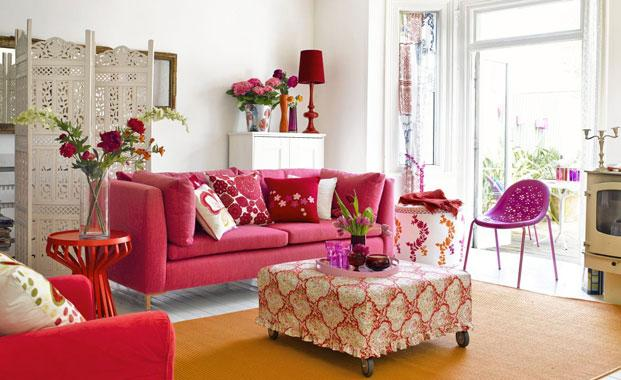 http://sarahbarksdaledesign.files.wordpress.com/2012/02/pink-couch-red-white-shabby-country-urban-home-interior-better-decorating-bible.jpg